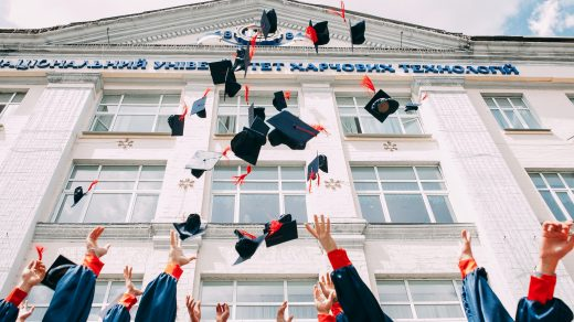 fresh graduates throwing their hat