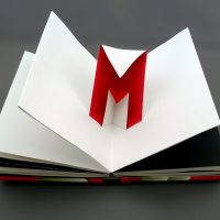 red pop up in the white book